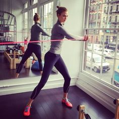 Karlie Kloss Building Muscle with Resistance Bands  | stylebistro.com