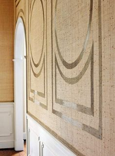 Raffia covered walls in a dining room ...and then a painted stencil on top to add just enough detail to make a big statement!