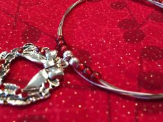 Christmas Wreath Bracelet made from Recycled Guitar Strings by 6stringsbyJK