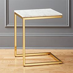 Shop Smart Marble Brass C Table. Sidekick to our smart round marble brass coffee table. This smaller but taller version pulls armside/bedside in a C of polished brass topped with Carrara-style white/grey marble. Marble Top Side Table, Marble End Tables, Metal Side Table, Modern Side Table, Side Tables, Brass Coffee Table, Coffee Table Design, Coffee Tables, Table Inox