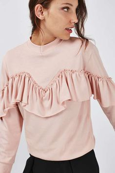Modern romance meets casual-cool with this pink sweatshirt featuring ruffle detail. We've styled with tailored culottes and white trainers for a trending feel. #Topshop