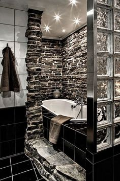 Trendy design, and the perfect bathtub to unwind your day. The sleek fixtures also add personality to this remodel. designs designs home design interior design 2012 Dream Bathrooms, Beautiful Bathrooms, Modern Bathrooms, Unusual Bathrooms, Dark Bathrooms, Rustic Bathrooms, Deco Originale, Style At Home, Home Fashion