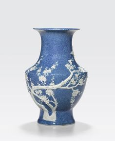 A robin's egg blue vase with white overlay decoration Late Qing/Republic period