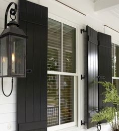 Classic Beauty in a White Farmhouse | Interior Design Gallery.  Love these shutters!