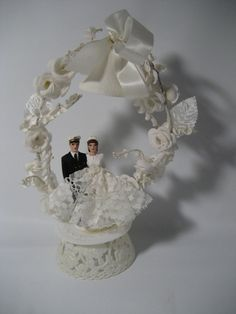 bride and Navy officer groom cake topper 1950 with floral arch via Etsy.