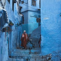 #woman walking down the #stairs in #chefchaouen, the #blue #town in #morocco…