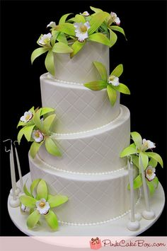 white #wedding cake topped with bright green flowers