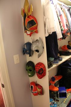 W's big boy room closet includes all his super hero and power ranger masks hanging on the wall for display and easy access. Used command hooks