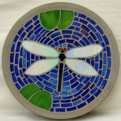 Dragonfly mosaic stepping stone by christina carrera Pin by Jane Shute on Mosaic Stepping Stones, Garden Paths . 2017 Dairy covered in Police Box fabric Like the filler for this stepping stone. Could be used to fill almost any round design. Mosaic Rocks, Mosaic Stepping Stones, Stone Mosaic, Mosaic Glass, Mosaic Tiles, Glass Art, Marble Mosaic, Tiling, Stained Glass Designs