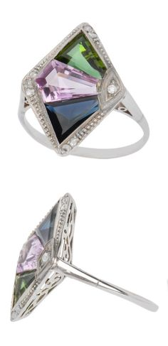 An Art Deco gem-set and diamond ring, circa 1925. Set with fancy-cut sapphire, shield-cut pink sapphire, fancy-cut peridot and rose-cut diamonds, mounted in white gold. #ArtDeco #ring