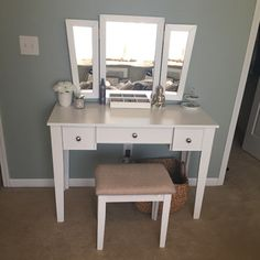 Elegant Features:  Tri Fold Mirror Vanity Table With Stool Set.  Two Small Drawer  And One Large Center Drawer. Number Of Items Included: Solid Wood Constr