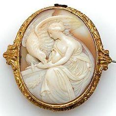 Google Image Result for http://eragem.com/media/catalog/product/cache/1/image/300x/5e06319eda06f020e43594a9c230972d/w/m/wm4770i-antique-shell-cameo-brooch-18k-gold.jpg