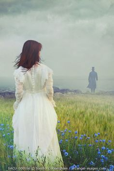 Woman walking in fields looking out to sea Out To Sea, After Dark, Gothic Fashion, Beautiful Images, Character Inspiration, Flower Girl Dresses, Portrait, Wedding Dresses, Fields