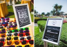 sunglasses for summer wedding, beach wedding ideas, funky wedding ideas, morning wedding ideas, sunglasses, blinded by love, unique signboards, funky