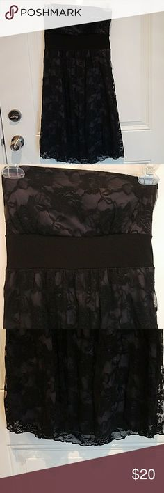 STRAPLESS BLACK FLORAL LACE ABOVE THE KNEE DRESS Black dress with floral lace and tie in the back ! Built in padding woen once for a wedding ! Lays right above the knee Poetry Dresses