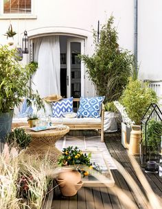 Gorgeous patterned pillows and bamboo furniture - patio and outdoor decor
