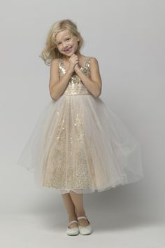 Gold sequined tea-length dress with shirred ivory tulle overlaid waistband and skirt. AD SHOT.