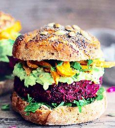 This gorgeous Vegan black bean/beet burger with guacamole + sweet potatoes. SO YUM!!  Raise your vibration, too!! Harm no animals....Peace begins within. Photo Credit: Goli Yoga #eatplantsnotfriends