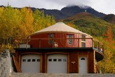 The typical single-room construction of a yurt means that modern conveniences, such as a bathroom or a garage addition, often are secondary structures incorporated into the overall design. This Alaskan home features a yurt perched atop a two-story garage Yurt Living, Tiny House Living, Two Story Garage, Alaskan Homes, Yurt Home, Round House, Modern House Design, Architecture, My Dream Home