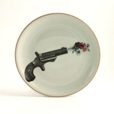 Altered Plate Gun Shooting Flowers on by MoreThanPorcelain on Etsy, €25.00