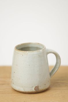 Small glazed clay coffee mug. Designed and made in Cornwall by the world famous Leach Pottery.