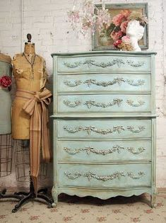 I knew I should have painted that dresser something other than white... but my guest room has the dress form, chadelier, and hat holder.... almost done