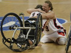 Christina Ripp and Loraine Gonzales of the U.S. Paralympic basketball team celebrate after winning their wheelchair basketball gold medal game against Germany. (2008)