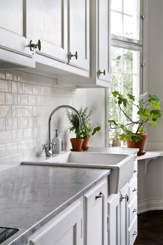 love love love this kitchen. exactly what I want....white subway tile, gray counters and a farmhouse sink.