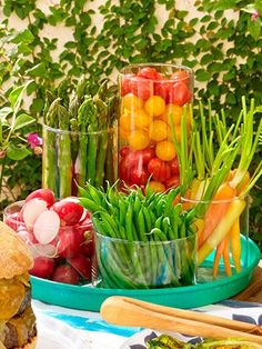 Snack on your centerpiece. Chop up vibrant veggies and put them in a tight grouping of pretty jars, bowls, or glass vases of varying sizes and heights. They'll look so lovely and bring the healthy.