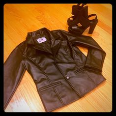 Faux Leather Jacket Made in Italy.. high quality and very cute.. paid a lot for it and never got to wear it (especially with cali weather ) open to offers.. might be real leather.. idk the difference cuz it feels so real Jackets & Coats