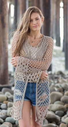The Matsu Cardi is a long crochet cardigan makes a wonderful beach cover-up that will become your go-to summer staple. It is worked top down for easy length adjustments. Created with a fluid, yarn-efficient lace stitch, this is casual with jeans or elegant with long linen pants.