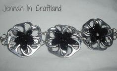 CLASSY recycled  black sparkely pop can tab flower bracelet. $16.53, via Etsy.
