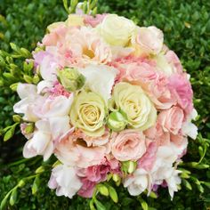 Bouquet with fresia, roses, lisianthus. by Purple Effect Events