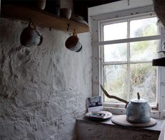 We love the use of wall texture to help complete the look in this rustic kitchen.