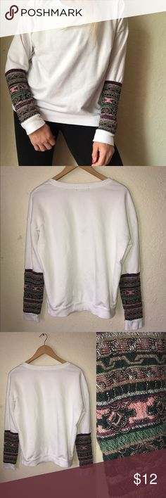 Forever 21 Sweatshirt With Designed Sleeves, L White sweatshirt with red , green & gold design on lower sleeves . Cute with jeans , gently worn, Size L by Forever 21 Forever 21 Tops Sweatshirts & Hoodies