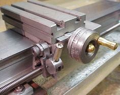 Taig lathe plus modifications - Split nut disengaged. Link and compression spring barely visible
