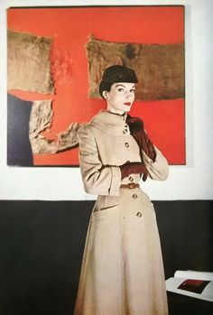 Coat: Zelinka-Matlick of Seventh Avenue (New York). Photo: Louise Dahl-Wolfe for Harper's Bazaar, 1955.