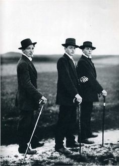 """""""Three young farmers in the way to a dance"""".  Circa 1914.    """"Secretary at West German Radio in Cologne"""" 1931, printed by the author during the 1950's.    Both by August Sander."""