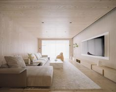Almost every surface of the living room is clad with Douglas fir wood.