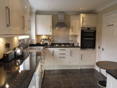 cream kitchen, black floor, wooden worktop - Google Search