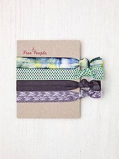 $10 Free People Clothing Boutique > Elastic Printed Hair Ties  Set of four colored/patterned elastic hair ties. Can be woven into braids, twisted into your hair, left dangling from the bottom, or used to tie your hair up. Adds a fun pop of color and texture to your hair for the music festivals! Can also be worn around your wrist as bracelets.