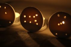 DIY Constellation Candleholders - air-dry clay votive holders. Could use cardboard (TP tube & cereal box) with LED tea lights