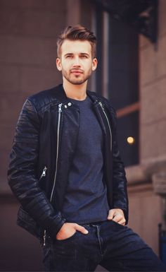 Fall men's fashion style. Classy and casual street outfit for autumn / fall. Featuring leather jacket, dark grey t-shirt, and dark navy jeans. For more street style outfits, click below.