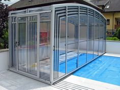Fully folded swimming pool enclosure VISION in silver color.