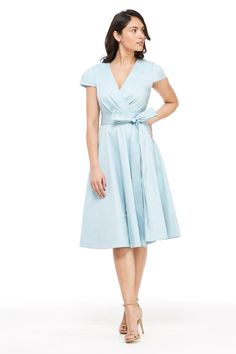Wrap dresses have always been a classic must-have and we love that this piece is distinguished by cap sleeves. A solid fit and flare, it features a cotton body, v-neckline and an elegant front tie that's easily transformable from day to night. Pastel Color Dress, Blue Dresses, Dresses For Work, Stylist Pick, Gal Meets Glam, Fit And Flare, Vintage Inspired, Wrap Dress, Dress Shoes