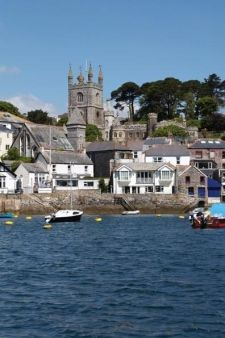 Fowey Waterfront with the 14th century Parish Church of St Finbarr, Cornwall, England