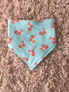 A personal favorite from my Etsy shop https://www.etsy.com/listing/262786007/aqua-and-orange-fox-bibdana-trendy-baby