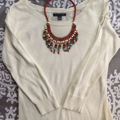 Mesh Back American Eagle Sweater Cream sweater with 3/4 sleeves and a mesh back. Perfect with any outfit or with a statement necklace as pictured here. NWOT. (Necklace not for sale) American Eagle Outfitters Sweaters