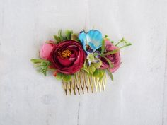 This faux flower hair comb features Blue, pink, green, and purple artificial flowers and greenery gold metal comb Measurements ( not including comb) 10cm Wide 4.5cm High This comb would be a perfect touch for your wedding day, photo shoots, Hens nights, birthdays or any other celebrations ♥ Faux Flowers, Flowers In Hair, Dried Flowers, Purple Flowers, Flower Hair, Metal Comb, Coloured Hair, Different Flowers, Tropical Flowers