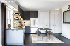 Williamsburg Kitchen features IKEA pre-built cabinet base system, cabinetry from Anthropologie, and open shelving repurposed from wood.